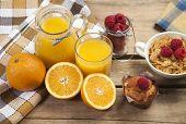 fresh orange juice and ripe fruits