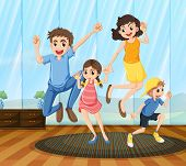 A happy family dancing inside the house