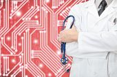 Doctor With Stethoscope In Hand And Circuit On Red Color Background