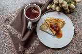 Closeup Of Cup Of Tea Nad Pancake