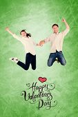 Couple jumping and holding hands against green vignette