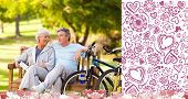 Elderly couple with their bikes against valentines pattern