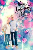pic of male pattern baldness  - Happy mature couple hugging and smiling against valentines heart design - JPG