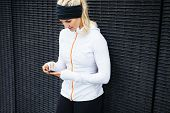 Woman Taking A Break Form Workout Using Mobile Phone