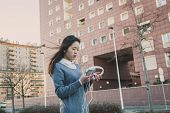 Young Beautiful Chinese Girl Posing In The City Streets
