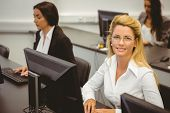 Smiling businesswoman working in computer room in the office