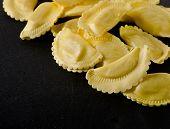 Italian Cheese Ravioli On A  Black Table
