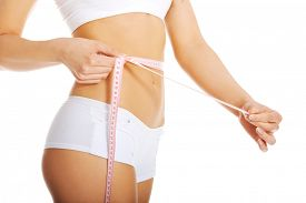 picture of measurement  - Woman measuring perfect shape of beautiful body - JPG