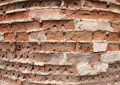 stock photo of fragmentation  - Fragment of the old wall of the destroyed bricks with wide angle distortion view - JPG