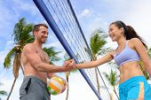 pic of beach-ball  - Handshake people in beach volleyball shaking hands after volley ball game on summer beach - JPG