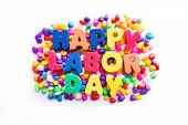 picture of labor  - happy labor day word in colorful stones - JPG