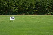 picture of fescue  - A new field of grass with a field closed sign on it - JPG