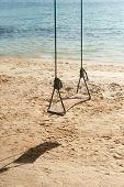 stock photo of off-shore  - Swings at  Ao Lungdam beach on Ko Samet  - JPG