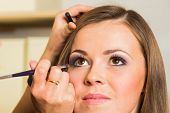 stock photo of eyebrows  - Makeup artist paints the eyebrows model - JPG
