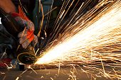 foto of people welding  - sparks while grinding in a steel factory - JPG