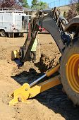 stock photo of street-rod  - Construction excavation contractor uses a level rod and laser to dig a trench for a concrete fondation wall