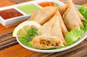 pic of samosa  - plate of vegetable samosa with indian sauces - JPG