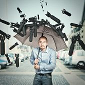 stock photo of bomb  - bombs and man try shield himself with umbrella - JPG