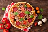 stock photo of wooden table  - Italian pizza with pepperoni - JPG