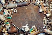 foto of workbench  - Workbench metal table with old water supply parts - JPG