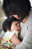 stock photo of priceless  - Precious And Priceless Mother Daughter Moment Of Loving Embrace - JPG