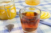 image of tea bag  - Cup of tea with a jar of honey and lemon slices on the table - JPG