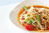 foto of green papaya salad  - Thai Papaya Salad spicy with vegetable on white table background - JPG
