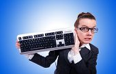 stock photo of nerd  - Nerd businessman with computer keyboard on white - JPG