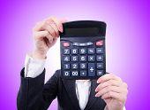stock photo of nerds  - Nerd female accountant with calculator - JPG