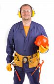 image of muff  - Worker in ear muffs holding hard hat - JPG