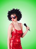 stock photo of pop star  - Pop star with mic in red dress on white - JPG