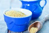 stock photo of porridge  - millet porridge in bowl and on a table - JPG
