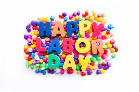 stock photo of labor  - happy labor day word in colorful stones - JPG