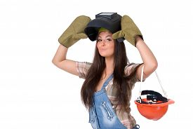 picture of welding  - Young sexy female dressed in jeans and weld helmet - JPG