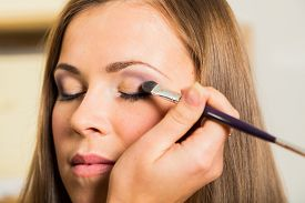 pic of eyebrows  - Makeup artist paints the eyebrows model - JPG