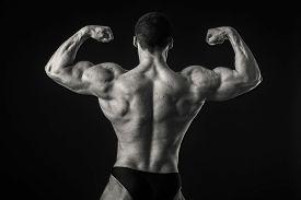 foto of strongman  - Strongman on a black background - JPG