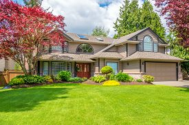 foto of in front  - Luxury house with beautiful landscaping on a sunny day - JPG