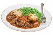 Casseroled beef with suet dumplings and peas