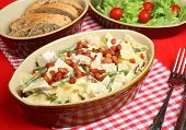 Farfalle pasta with chicken, asparagus and pancetta in a cream sauce