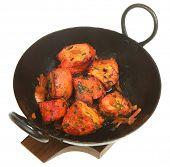 Chicken tikka in sizzler serving dish