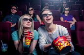 People in the cinema wearing 3d glasses poster
