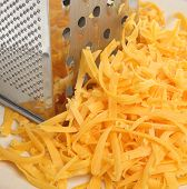 Grated cheese with grater.