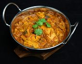 Indian chicken curry in balti serving dish.