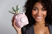 picture of piggy_bank  - African american woman holding piggy bank - JPG