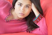 stock photo of american indian  - Close up of woman on sofa - JPG