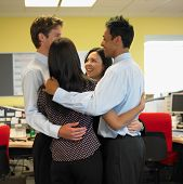 Business people in group hug
