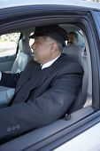 Close up of chauffeur driving car