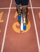 Rear view of track athlete at starting line