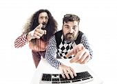 Two weird computer geeks having fun on computer poster