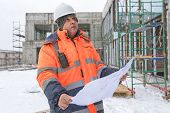 Постер, плакат: Senior Foreman At Construction Site In Winter